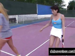 Breasty lesbos masturbating on the tennis field