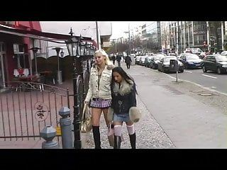 Tall golden-haired and petite brunette hair lesbos in public